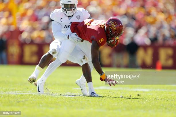 Linebacker Ulysees Gilbert III of the Akron Zips tackles wide receiver Deshaunte Jones of the Iowa State Cyclones as he rushed for yards in the first...