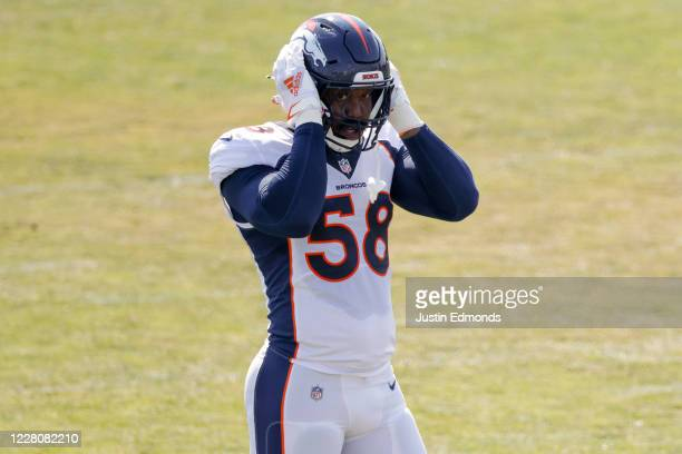 Linebacker Von Miller of the Denver Broncos adjusts his helmet during a training session at UCHealth Training Center on August 17, 2020 in Englewood,...