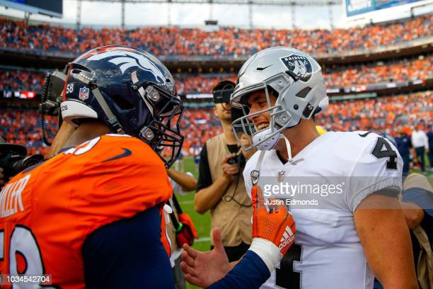 Linebacker Von Miller of the Denver Broncos greets quarterback Derek Carr of the Oakland Raiders on the field after a 20-19 Denver Broncos win at...