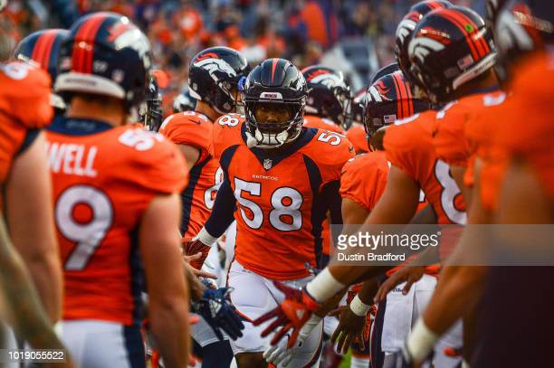 linebacker Von Miller of the Denver Broncos runs onto the field during player introductions an NFL preseason game against the Chicago Bears at...