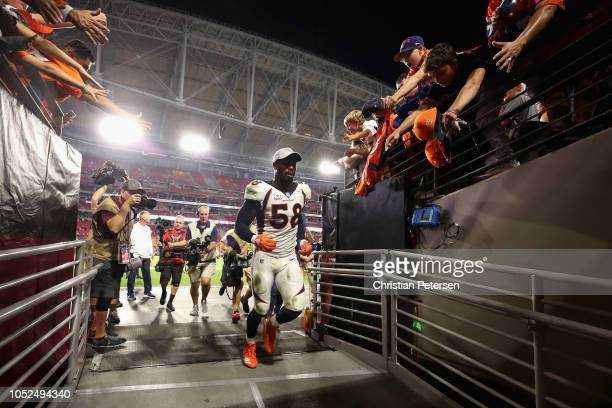 Linebacker Von Miller of the Denver Broncos runs past fans as he leaves the field following the NFL game against the Arizona Cardinals at State Farm...