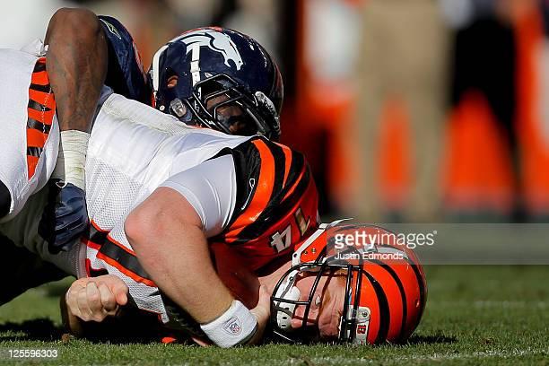 Linebacker Von Miller of the Denver Broncos sacks quarterback Andy Dalton of the Cincinnati Bengals during the fourth quarter at Sports Authority...
