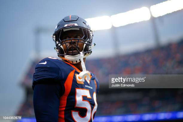 Linebacker Von Miller of the Denver Broncos stands on the field before a game against the Kansas City Chiefs at Broncos Stadium at Mile High on...