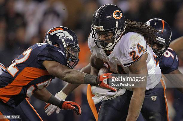 Linebacker Wesley Woodyard of the Denver Broncos strips the ball from running back Marion Barber of the Chicago Bears causing a fumble which was...