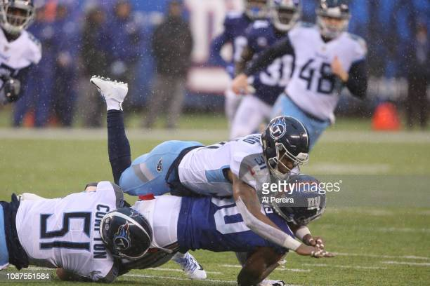 Linebacker Will Compton and Safety Kevin Byard of the Tennessee Titans in action against the New York Giants at MetLife Stadium on December 16, 2018...
