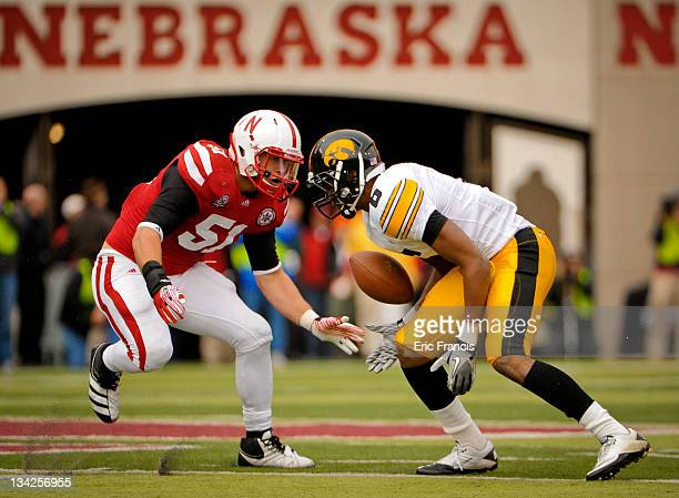 Linebacker Will Compton of the Nebraska Cornhuskers draws a bead on wide receiver Keenan Davis of the Iowa Hawkeyes during their game at Memorial...