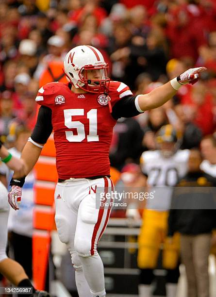 Linebacker Will Compton of the Nebraska Cornhuskers points toward his teammates after making a tackle during their game at Memorial Stadium November...