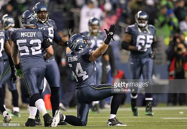 Linebacker Will Herring of the Seattle Seahawks celebrates an interception against the St Louis Rams during the fourth quarter of their game at Qwest...