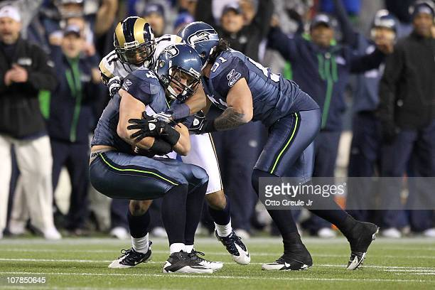 Linebacker Will Herring of the Seattle Seahawks interceps a pass by quarterback Sam Bradford of the St Louis Rams during the fourth quarter of their...