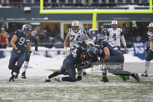 Linebacker WIll Herring of the Seattle Seahawks stops Running Back Leon Washington of the New York Jets on December 21 2008 when the New York Jets...