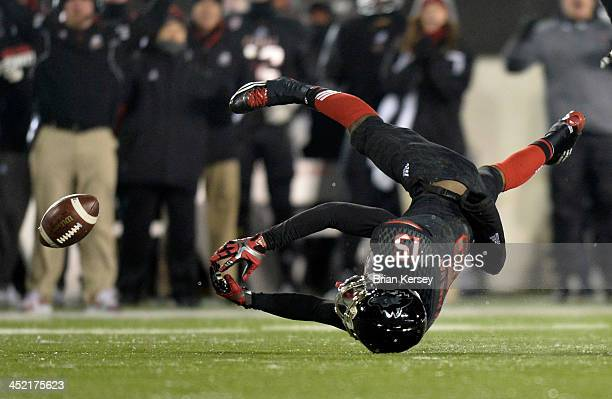 Linebacker Zach Anderson of the Northern Illinois Huskies tries for an interception but cannot hold onto the ball during the third quarter against...