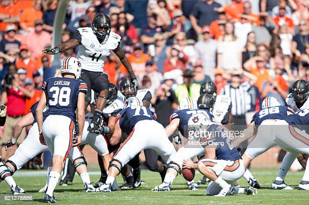 Linebacker Zach Cunningham of the Vanderbilt Commodores hopes over the Auburn Tigers line to block a field goal at Jordan-Hare Stadium on November 5,...