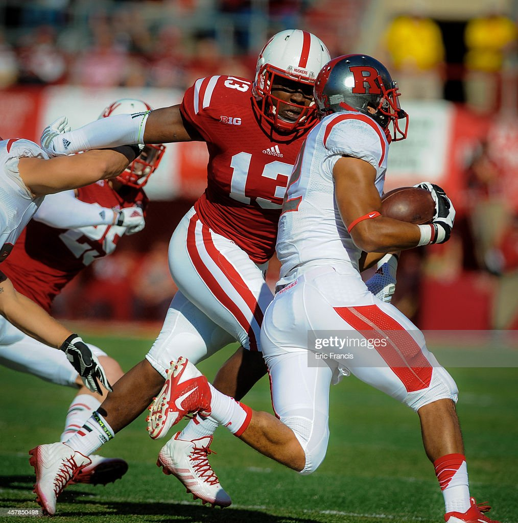 Linebacker Zaire Anderson #13 of the Nebraska Cornhuskers bears down on running back Justin Goodwin #32 of the Rutgers Scarlet Knights during their game at Memorial Stadium on October 25, 2014 in Lincoln, Nebraska.