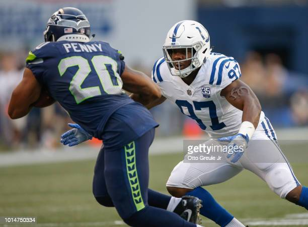 Linebacker Zaire Franklin of the Indianapolis Colts pursues running back Rashaad Penny of the Seattle Seahawks at CenturyLink Field on August 9 2018...