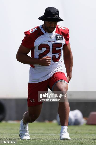 Linebacker Zaven Collins of the Arizona Cardinals participates in an off-season workout at Dignity Health Arizona Cardinals Training Center on June...
