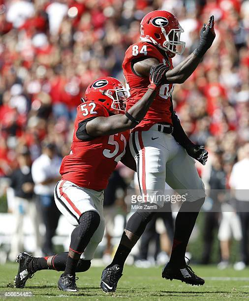Linebackers Amarlo Herrera and Leonard Floyd of the Georgia Bulldogs celebrate after a sack during the game against the Vanderbilt Commodores at...