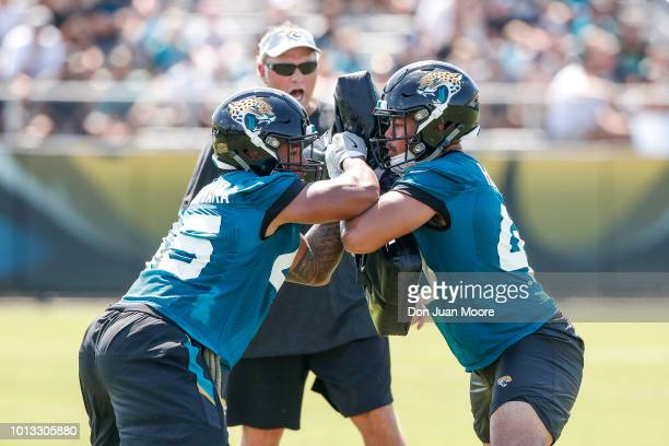 Linebackers Andrew Motuapuaka and Manase Hungalu work on drills as Special Teams Coordinator Joe Decamillis of the Jacksonville Jaguars overseas...