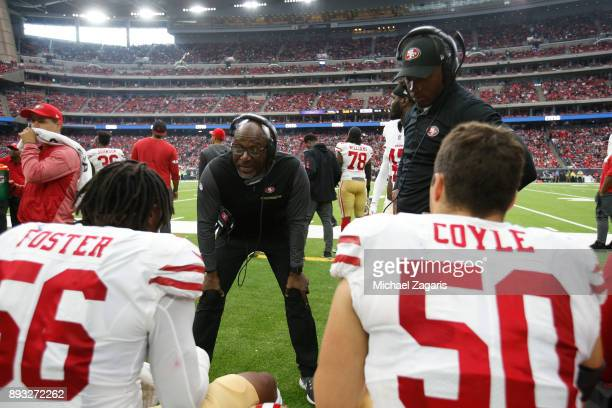 Linebackers Coach Johnny Holland of the San Francisco 49ers talks with Reuben Foster and Brock Coyle on the sideline during the game against the...