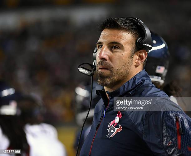 Linebackers coach Mike Vrabel of the Houston Texans looks on from the sideline during a game against the Pittsburgh Steelers at Heinz Field on...