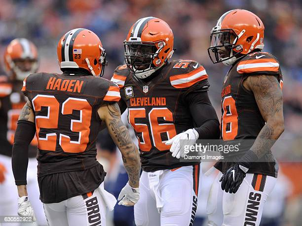 Linebackers Demario Davis and Christian Kirksey of the Cleveland Browns congratulates cornerback Joe Haden after a tackle for loss by Haden during a...