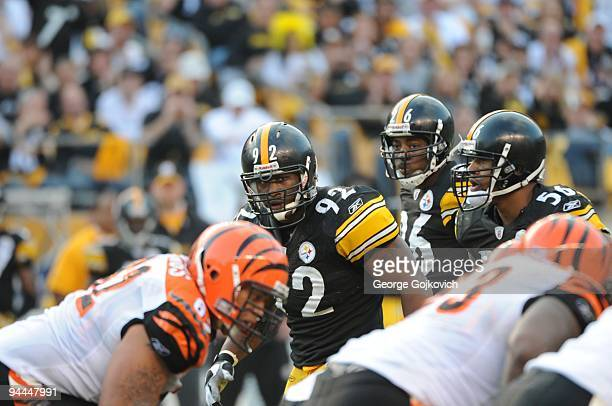Linebackers James Harrison and LaMarr Woodley and cornerback Deshea Townsend of the Pittsburgh Steelers look across the line of scrimmage during a...