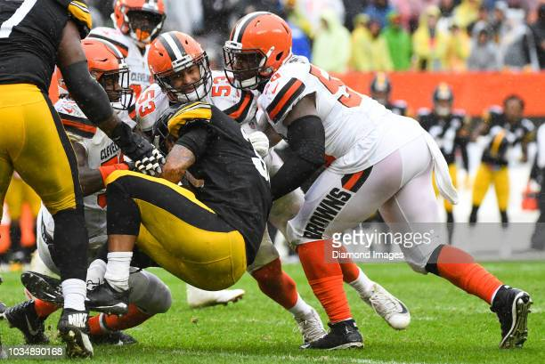 Linebackers Jamie Collins Joe Schobert and defensive end Chris Smith of the Cleveland Browns tackle running back James Conner of the Pittsburgh...