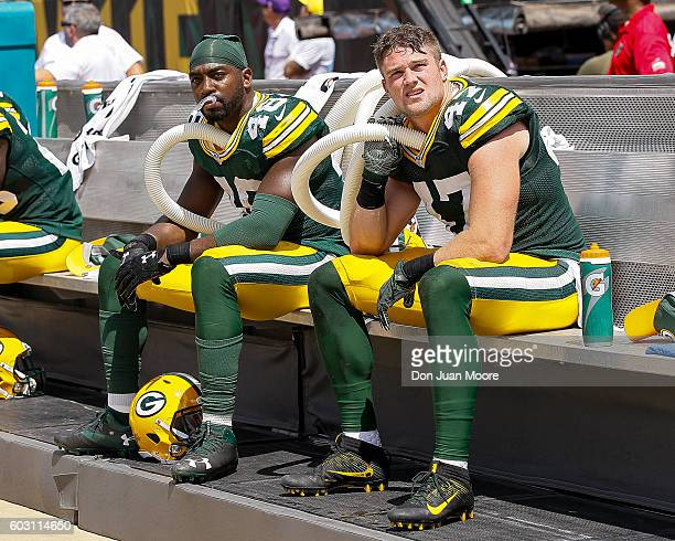 Linebackers Joe Thomas and Jake Ryan of the Green Bay Packers try to stay cool by running tubes of cold air under their jerseys during the game...