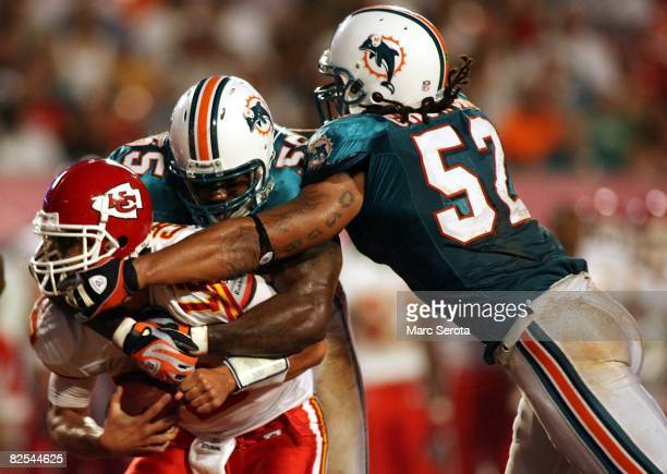 Linebackers Joey Porter and Channing Crowder of the Miami Dolphins sack quarterback Brody Croyle of the Kansas City Chiefs during a pre season game...