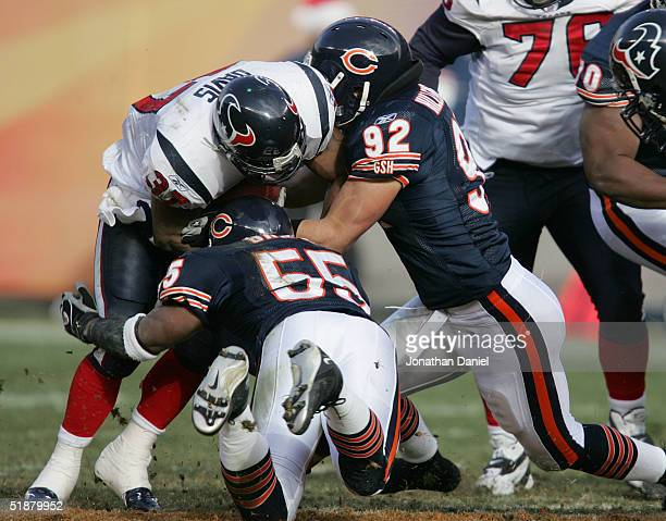 Linebackers Lance Briggs and Hunter Hillenmeyer of the Chicago Bears stop running back Domanick Davis of the Houston Texans December 5 2004 at...