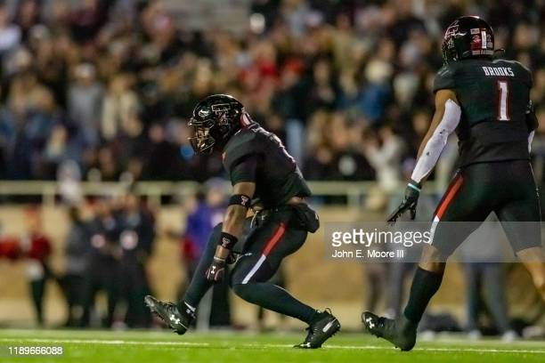 Linebackers Riko Jeffers and Jordyn Brooks of the Texas Tech Red Raiders celebrate after a play during the second half of the college football game...
