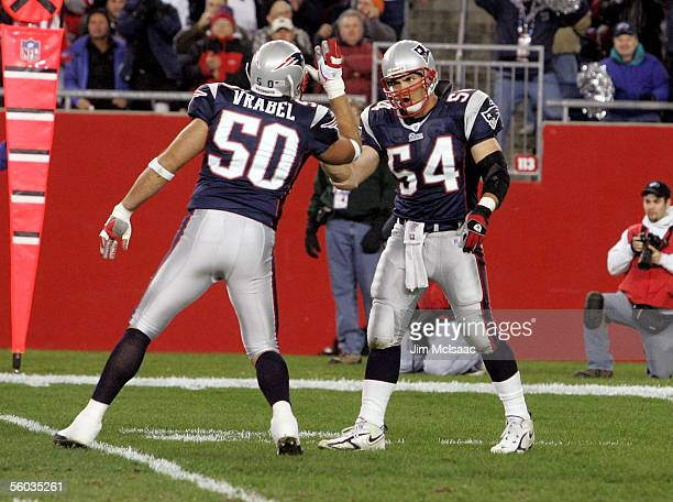 Linebackers Tedy Bruschi and Mike Vrabel of the New England Patriots celebrate a tackle against the Buffalo Bills at Gillette Stadium October 30 2005...