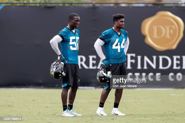 Linebackers Telvin Smith Sr #50 and Myles Jack of the Jacksonville Jaguars take a break during Training Camp at Dream Finders Homes Practice Complex...