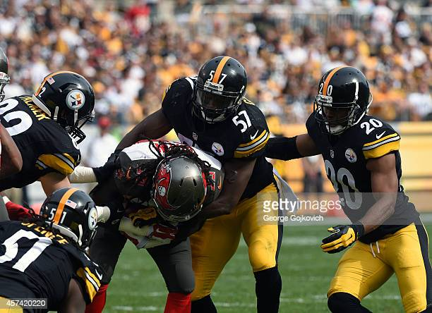 Linebackers Terence Garvin and Sean Spence tight end Michael Palmer and safety Will Allen of the Pittsburgh Steelers tackle Brandon Dixon of the...
