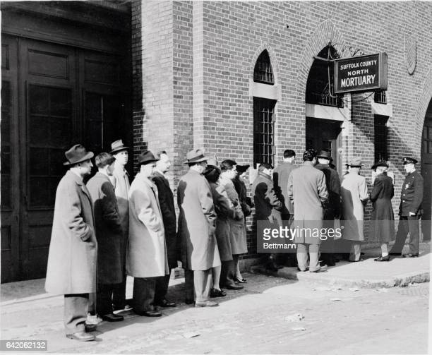 Lined up outside the Suffolk County North Mortuary stunned relatives wait their turn to be led twobytwo before the lines of Cocoanut Grove Night Club...