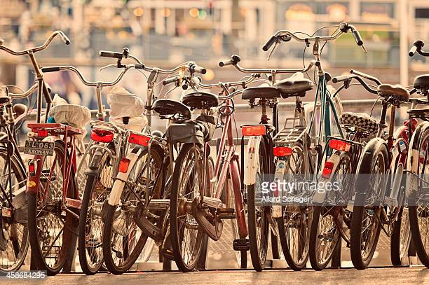Lined-up bicycles in parking near Amsterdam Central Station, Amsterdam, Netherlands. Selective focus and shallow depth of field.