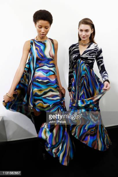 Lineisy Montero Feliz and Grace Elizabeth are seen backstage ahead of the Roberto Cavalli show at Milan Fashion Week Autumn/Winter 2019/20 on...