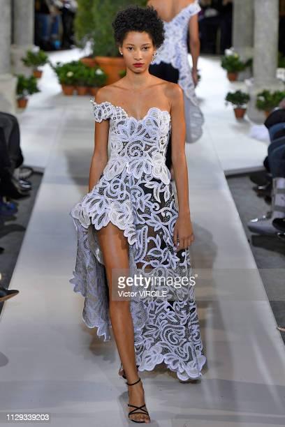 Lineisy Montero walks the runway at Oscar De La Renta Ready to Wear Fall/Winter 20192020 fashion show during New York Fashion Week on February 12...