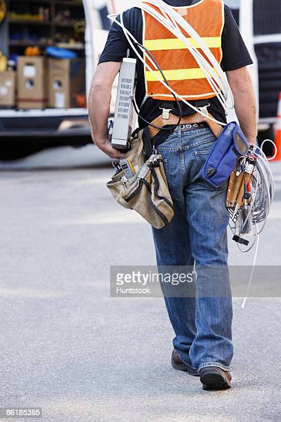 Lineman carrying a modem