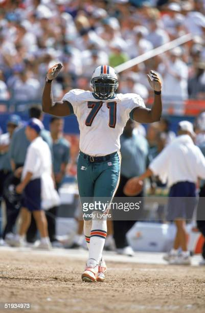 Lineman Dunstan Anderson of the Miami Dolphins celebrates during the game against the Kansas City Chiefs at Pro Player Stadium on October 5 1997 in...
