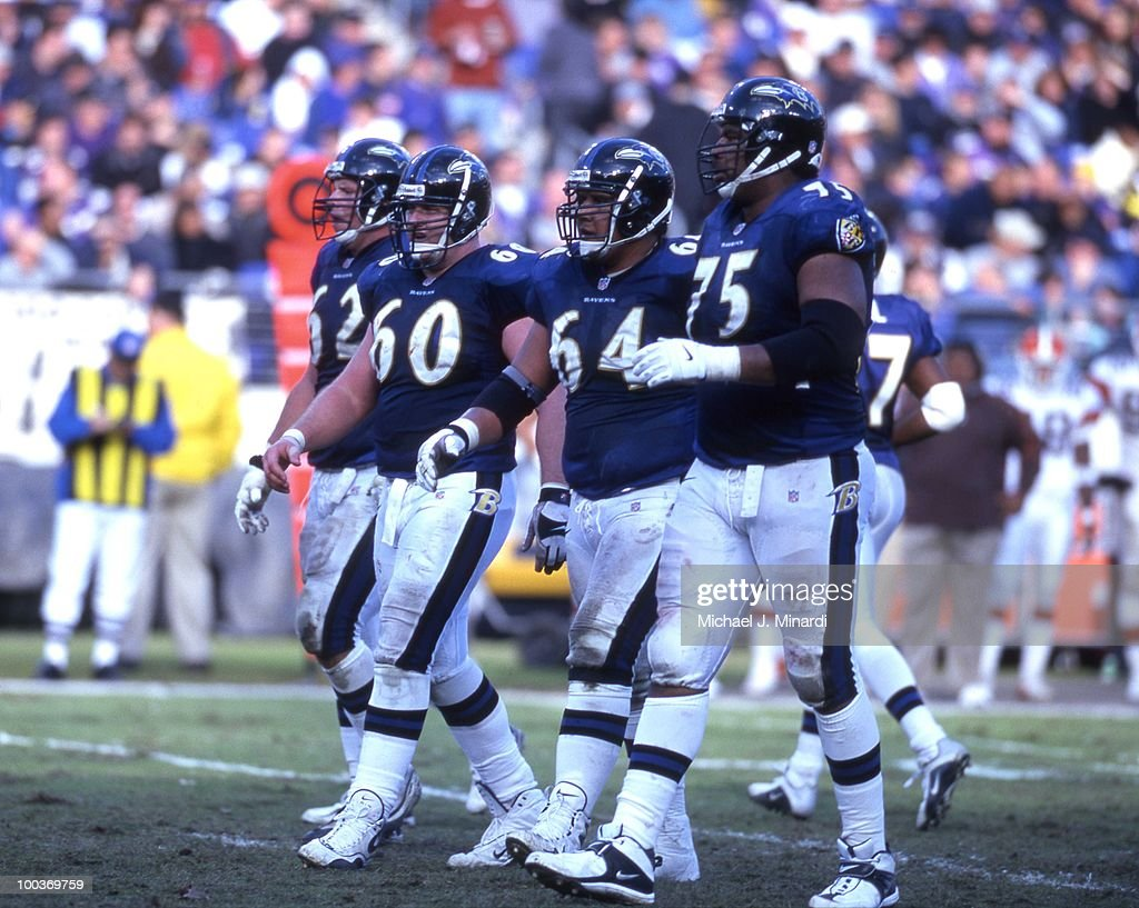 Lineman Mike Flynn #62, Center Jeff Mitchell #60, Lineman Edwin Mulitalo #64, and Jonathan Ogden #75 of the Baltimore Ravens Offense come up to the scrimmage line in a NFL game against the Cleveland Browns at PSINet Stadium on November 26, 2000 in Baltimore, Maryland. The Ravens won 44 to 7.