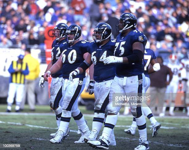 Lineman Mike Flynn, Center Jeff Mitchell, Lineman Edwin Mulitalo, and Jonathan Ogden of the Baltimore Ravens Offense come up to the scrimmage line in...