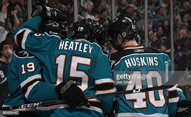 Linemates Joe Thornton, Dany Heatley and Kent Huskins celebarte the goal of Patrick Marleau of the San Jose Sharks during an NHL game against the...