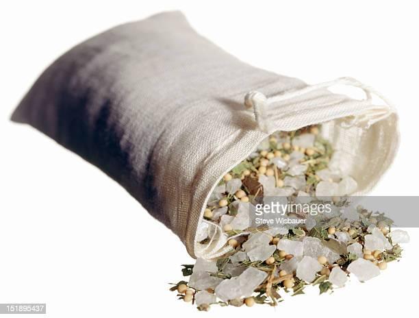 A linen bag filled with bath salts