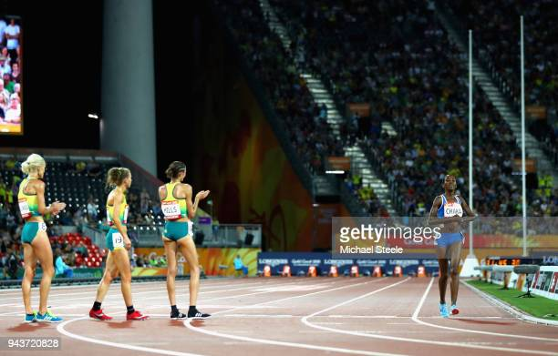 Lineo Chaka of Lesotho is applauded by Eloise Wellings of Australia Madeline Hills of Australia and Celia Sullohern of Australia as she finishes the...