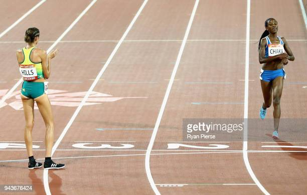 Lineo Chaka of Lesotho is applauded by Madeline Hills of Australia as she finishes the Women's 10000 metres final during the Athletics on day five of...
