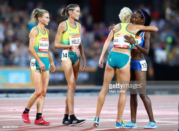 Lineo Chaka of Lesotho is greeted by Eloise Wellings of Australia, Madeline Hills of Australia and Celia Sullohern of Australia as she finishes the...