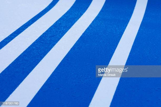 lines and details of blue and white racing stripes and dew drops - white stripes stock pictures, royalty-free photos & images