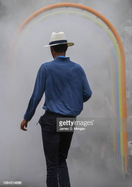 A lines court judge walks towards an archway of water mist during day two of the 2019 Australian Open at Melbourne Park on January 15 2019 in...