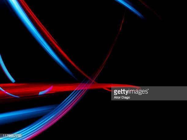 lines forming a futuristic structure in 3d. - esposizione lunga foto e immagini stock