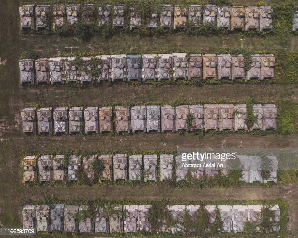 lines of abandoned tanks photographed by a drone, italy - armory stock pictures, royalty-free photos & images